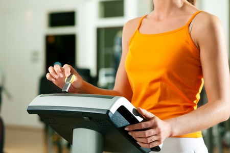 Woman exercising with modern key system Stock Photo - 9415522