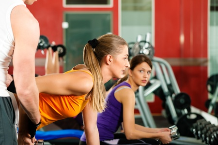 People in gym exercising with weights   Stock Photo - 9415550