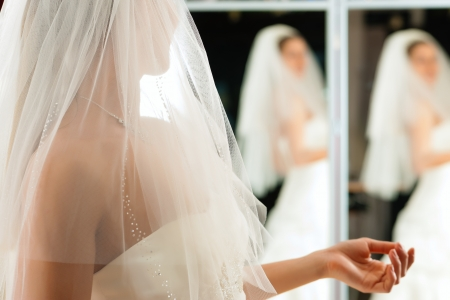 Bride at the clothes shop for wedding dresses photo
