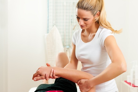Patient at the physiotherapy doing physical exercises photo