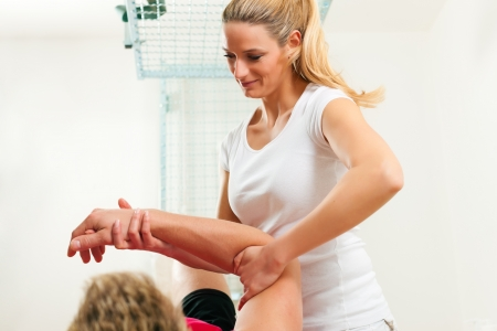 Patient at the physiotherapy doing physical exercises Stock Photo - 9860568