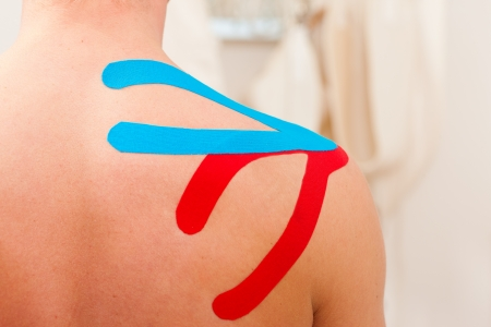 physical exercise: Patient at the physiotherapy with different tapes