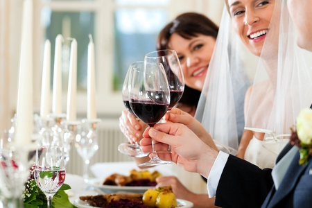 Wedding party at dinner - the bridal couple with guests Stock Photo - 9860660