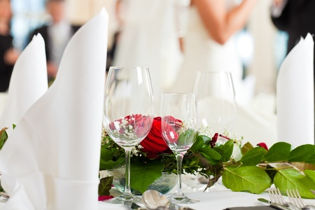 wedding guest: Wedding table at a wedding feast decorated with flowers