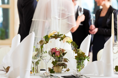 Wedding table at a wedding feast decorated with flowers photo