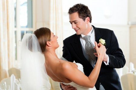 Bride and groom dancing the first dance at their wedding day Stock Photo - 9860684