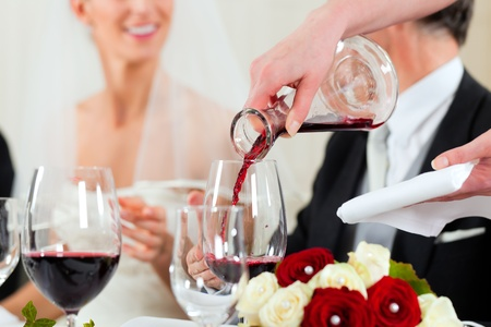 wedding guest: Wedding party at dinner - the dish is going to be served Stock Photo