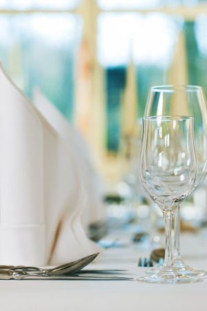 Wedding - feastfully decorated table with silverware and glasses Stock Photo - 9860776