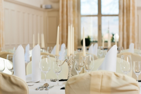 Wedding - feastfully decorated table with silverware and glasses photo