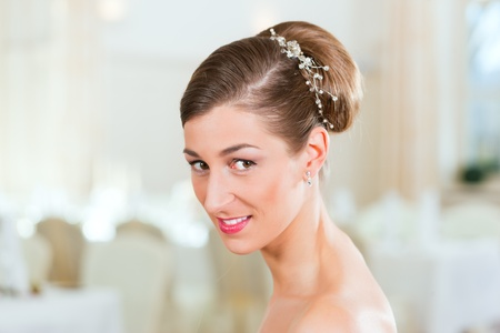Smiling bride with swept-back hair before the wedding Stock Photo - 9860608