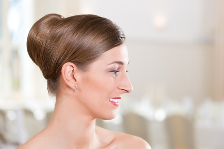 Smiling bride with swept-back hair before the wedding Stock Photo - 9860546