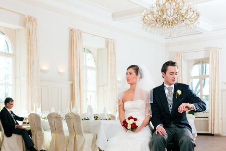 Bridal couple waiting for ceremony in a decorated hall Stock Photo - 9860573