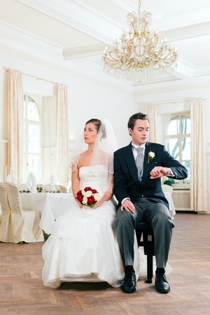 bridal couple: Bridal couple waiting for ceremony in a decorated hall Stock Photo