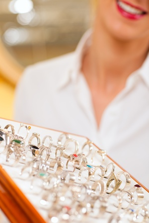 jeweler: Shop assistant at the jeweler with jewellery