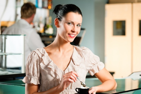 Woman in a coffeeshop or cafe enjoys her cappuccino photo