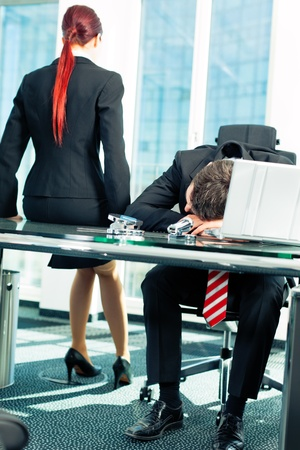 project deadline: Business - nap in the office to relieve stress Stock Photo