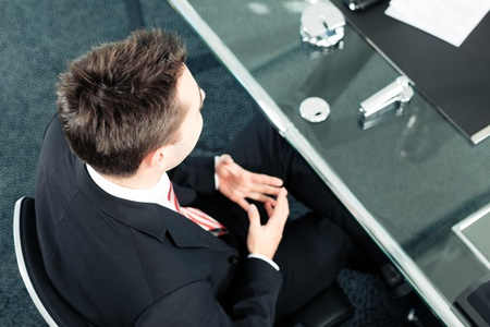 JOB INTERVIEW: Business - young man sitting in job Interview Stock Photo