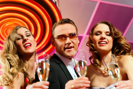 People with champagne in a bar or casino having lots of fun Stock Photo - 9860710