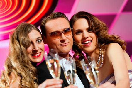 People with champagne in a bar or casino having lots of fun Stock Photo - 9860242