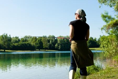 Fishing at the lake at a beautiful summer day Stock Photo - 9844614
