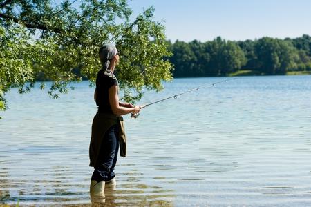 Fishing at the lake at a beautiful summer day Stock Photo - 9860849