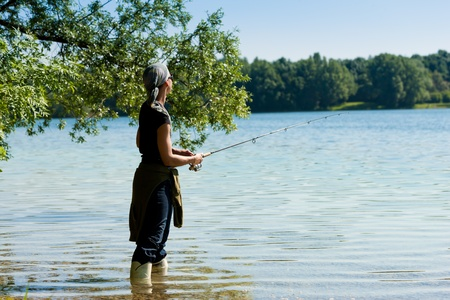 Fishing at the lake at a beautiful summer day Stock Photo - 9860849
