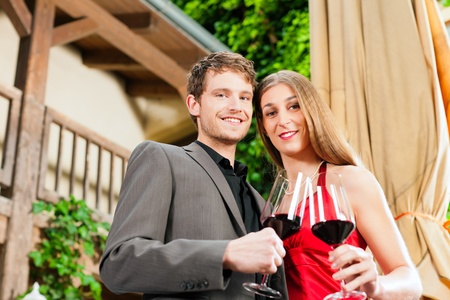 Couple, man and woman, at winetasting in a restaurant, each with glass of red wine in hand Stock Photo - 9860839