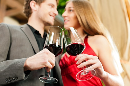 renowned: Couple at winetasting with red wine in a restaurant