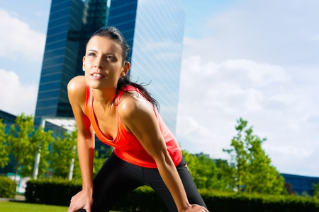 Urban sports - fitness in the city on a beautiful summer day Stock Photo - 9860622