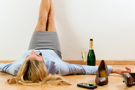 Businesswoman is lying on the floor at home relaxing photo