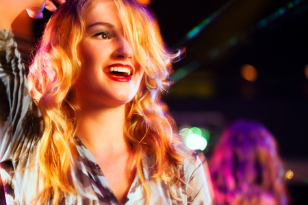 Clubbing and nightlife - Woman in club or bar having fun   Stock Photo - 10050913