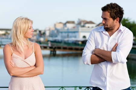 couples therapy: Couple having a discussion in summer in their vacation