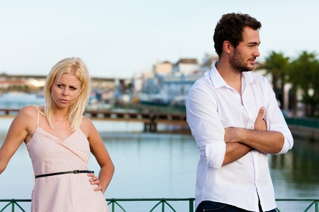 Couple having a discussion in summer in their vacation photo