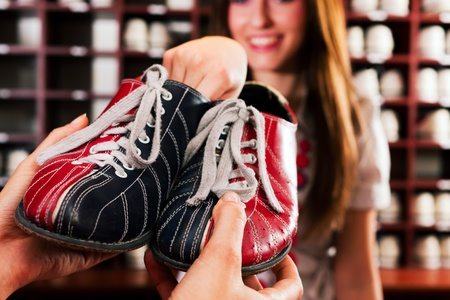 Woman borrow some shoes for bowling in an entertainment club Stock Photo - 10040963