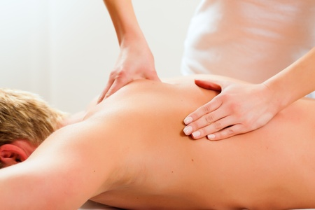 Patient at the physiotherapy gets massage or lymphatic drainage Stock Photo - 10040971