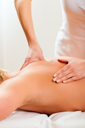 back massage: Patient at the physiotherapy gets massage or lymphatic drainage Stock Photo