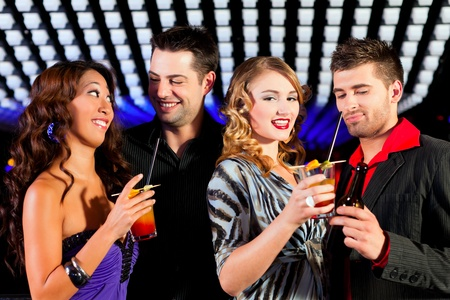 Group of party people with cocktails in a bar or club having fun Stock Photo - 10040966