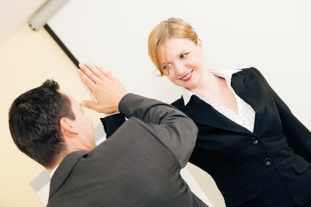 Two people in Business giving each other a high five for a successful transaction Stock Photo
