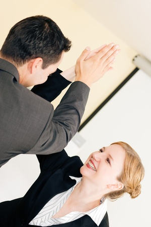 business transaction: Two people in Business giving each other a high five for a successful transaction Stock Photo