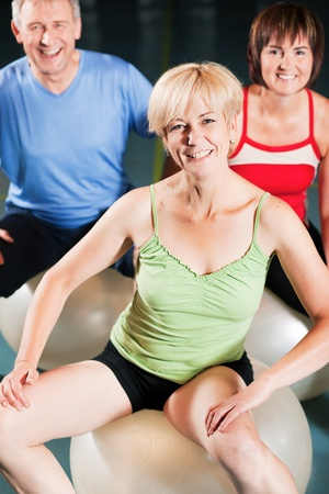 Senior people in a gym exercising with fitness ball  Stock Photo - 10257430