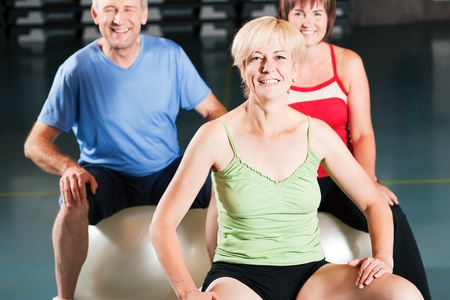 Senior people in a gym exercising with fitness ball Stock Photo - 10256920