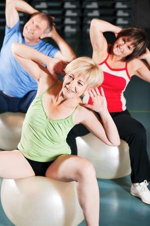 gym ball: Senior people in a gym exercising with fitness ball    Stock Photo