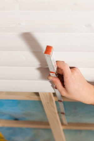 Man doing dry walling, working with a folding rule Stock Photo - 10269888