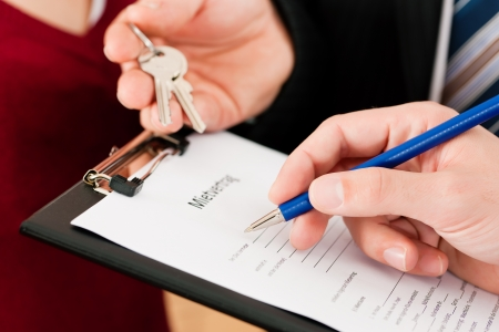 relocating: Rent an apartment - Signing tenant agreement; close-up on form Stock Photo