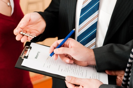 lease: Rent an apartment - Signing tenant agreement; close-up on form Stock Photo