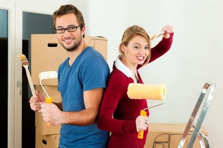 tenant: Young couple moving in a home or apartment, they are painting and doing renovation work