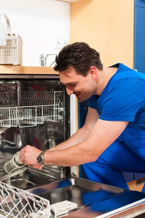 dishwasher: Technician or plumber repairing the dishwasher in a household
