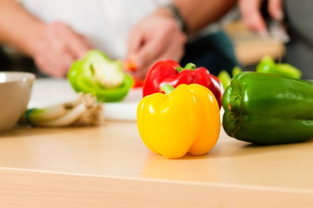 Man in the kitchen – only hands to be seen – is preparing the vegetables for dinner or lunch Stock Photo - 10269889
