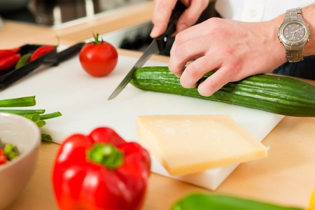 Man in the kitchen – only hands to be seen – is preparing the vegetables for dinner or lunch Stock Photo - 10268851