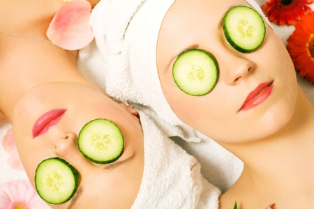 cucumber slice: Girls in a beauty treatment with cucumber slices